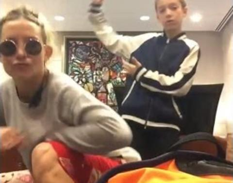 Kate hudson son dance to trap queen in airport lounge