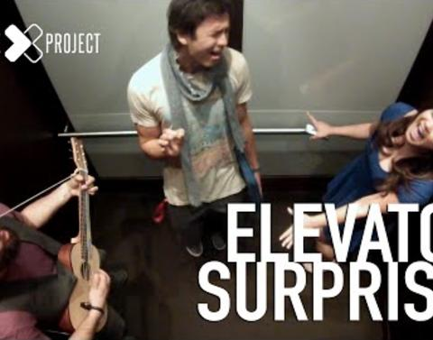 Strangers sing in an elevator takes passengers by delighted surp