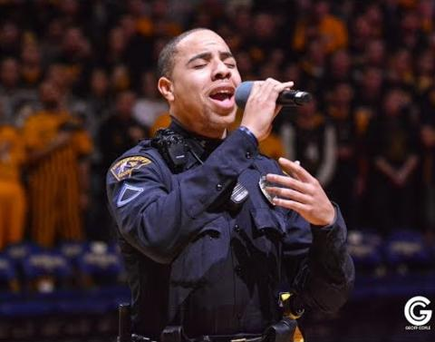Cop steps in to nail national spontaneous national anthem