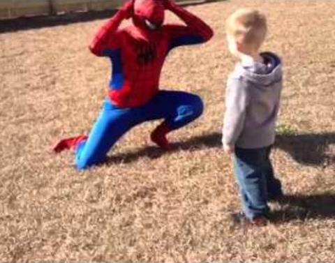 Marine plays spiderman to give son super sized surprise