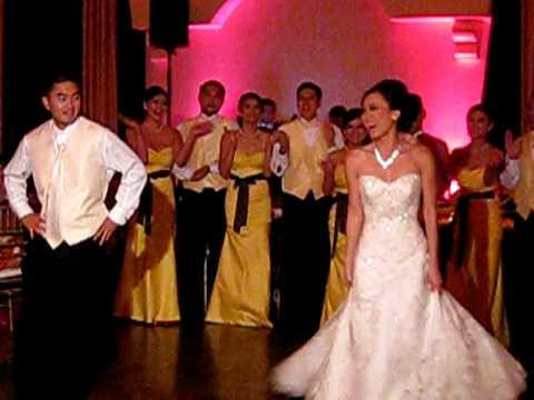 Newlyweds Turn Boring First Dance Into Grease Themed Masterpiece