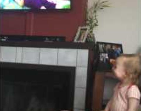 Little girl finds footage of herself to be hilarious