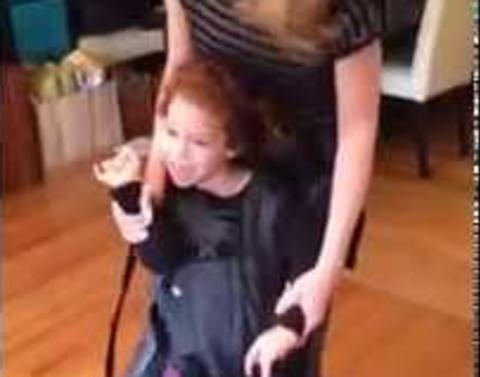 Girl with cerebral palsy enjoys first ever dance