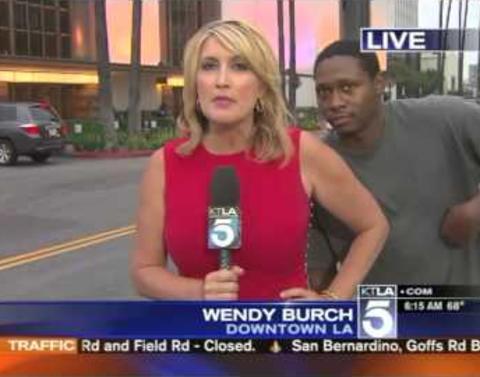 Gold medal videobomb scares bejesus out of reporter