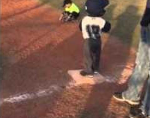 Little boy gets bored during baseball gameand then does this