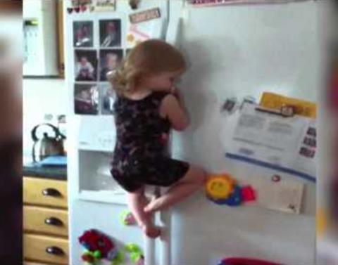Ninja kid climbs up fridge to get snack
