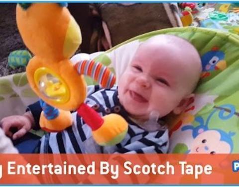 Baby loves scotch tape